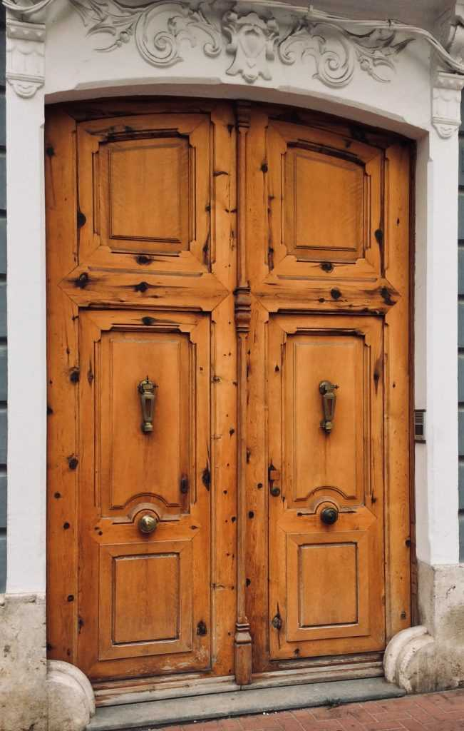 Carved wooden door in Oliva, Valencia, Spain