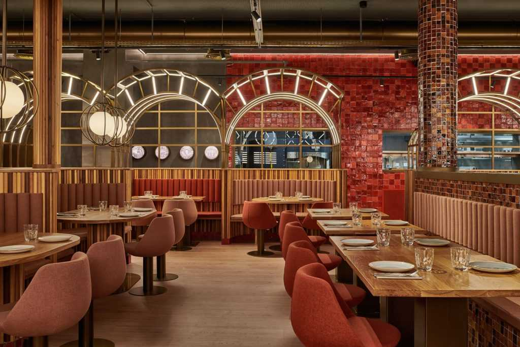 The Piur restaurant in Valencia. Touches of red reference tomatoes used in pizzas. Photography: Luis Beltran